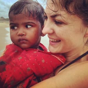Aideen with a child at Mahabalipuram beach